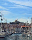 Notre-Dame de la Garde over the Bay. Marseille France - view of Notre-Dame de la Garde from Marseille Vieux Port Stock Photo