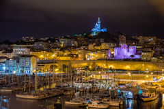 Notre-Dame de la Garde over the Old Port in Marseille Stock Images