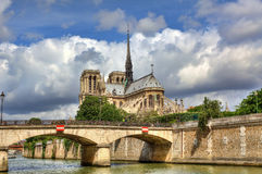 Notre Dame de Paris Cathedral. View on famous Notre Dame de Paris Cathedral under beautiful cloudy sky in Paris, France Royalty Free Stock Images