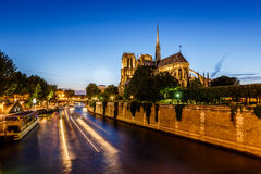 Notre Dame de Paris Cathedral and Boat Lights Trails Royalty Free Stock Photo