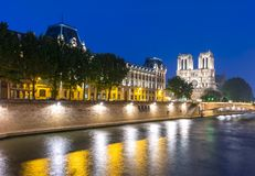 Notre-Dame de Paris Cathedral and Cite island embankment at night, France royalty free stock photography