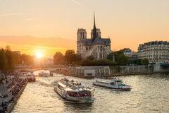Notre Dame de Paris cathedral with cruise ship in Seine river Royalty Free Stock Images