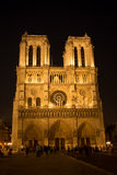 Notre Dame de Paris. Notre Dame cathedral facade at night in Paris, France Royalty Free Stock Image