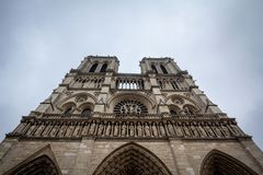 Notre Dame de Paris Cathedral in Paris, France, taken from the bottom during a grey afternoon. royalty free stock photography