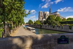 Notre Dame de Paris cathedral and the Seine River in Summer. Paris, France. Notre Dame de Paris cathedral on Ile de La Cite with the Seine River in summer. Pont Royalty Free Stock Image