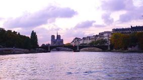 Notre Dame de Paris Cathedral and the River Seine. View of Notre Dame de Paris Cathedral and the River Seine from sightseeing cruise ship stock footage
