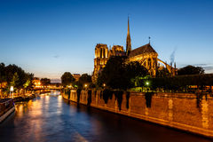 Notre Dame de Paris Cathedral and Seine River in the Evening Stock Images