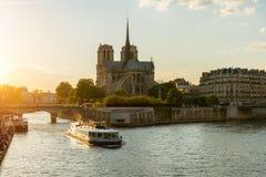 Notre Dame de Paris with cruise ship on Seine river in Paris, Fr stock photography