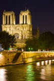 Notre Dame de Paris at a dark night Stock Photos