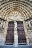Notre Dame de Paris, Gothic portal, France. Notre Dame de Paris cathedral featuring a central gothic portal and bas relief of the Last Judgement. The heavy Stock Photo