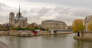 Notre Dame de Paris. Landmark and touristic spot: Gothic Notre Dame de Paris Cathedral on the the Seine river in Paris, France, by an autumn cloudy day with Royalty Free Stock Image
