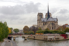 Notre Dame de Paris. Landmark and touristic spot: Gothic Notre Dame de Paris Cathedral on the the Seine river in Paris, France, by an autumn cloudy day with Royalty Free Stock Photography