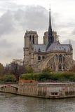 Notre Dame de Paris. Landmark and touristic spot: Gothic Notre Dame de Paris Cathedral on the the Seine river in Paris, France, by an autumn cloudy day with Stock Images