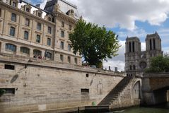 Notre Dame de Paris, landmark, waterway, building, town. Notre Dame de Paris is landmark, town and palace. That marvel has waterway, château and tourist Royalty Free Stock Images