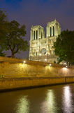 Notre Dame de Paris at night Stock Images