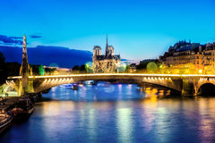 Notre dame de Paris at night and the seine river France. Stock Photo