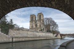 Notre Dame de Paris over the Seine River Stock Photography