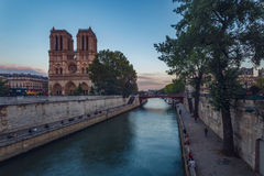 Notre Dame de Paris over the Seine River Stock Images