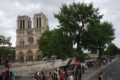 Notre Dame de Paris, Paris, tree, car, plant, city. Notre Dame de Paris, Paris is tree, city and street. That marvel has car, building and cathedral and that Stock Photos
