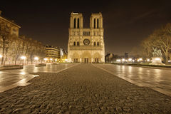 Notre Dame de Paris without people. Night View of Notre Dame de Paris, France and square in front of the cathedral without people Stock Images