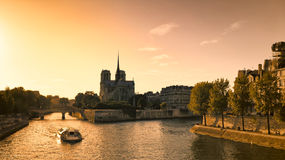 Notre Dame de Paris and River Seine. Notre Dame cathedral in Paris, France, and River Seine with a sightseeing boat Stock Images