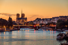 Notre Dame de Paris and Seine River at sunset. Paris. Notre Dame de Paris Cathedral, Ile Saint Louis and the Seine River at sunset. Summer evening with the Sully Stock Photos