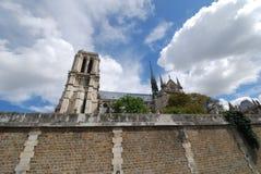 Notre Dame de Paris, sky, cloud, building, historic site. Notre Dame de Paris is sky, historic site and facade. That marvel has cloud, roof and ancient history Stock Image