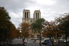 Notre Dame de Paris, sky, building, landmark, tree. Notre Dame de Paris is sky, tree and urban area. That marvel has building, woody plant and downtown and that stock photos