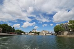 Notre Dame de Paris, sky, waterway, cloud, water. Notre Dame de Paris is sky, water and tree. That marvel has waterway, body of water and reflection and that stock images