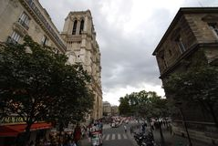 Notre Dame de Paris, sky, woody plant, city, tree. Notre Dame de Paris is sky, tree and landmark. That marvel has woody plant, urban area and infrastructure and Stock Photography