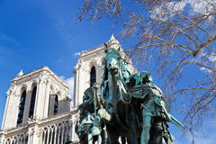 Statue of Statue Of Charlemagne in Paris. Notre Dame de Paris and statue of Statue Of Charlemagne Royalty Free Stock Images