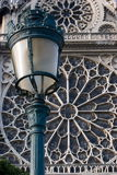 Notre Dame de Paris street lamp. Street lamp against Notre Dame Cathedral detail stock photo