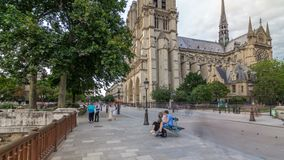 Notre-Dame de Paris timelapse hyperlapse, a medieval Catholic cathedral on the Cite Island in Paris, France. Notre-Dame de Paris timelapse hyperlapse is a stock video