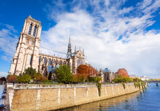 Notre Dame de Paris towering the Seine Stock Image