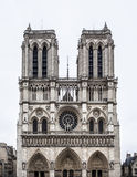 Notre Dame de Paris with white sky. Stock Photos