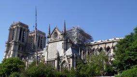 Notre Dame de Paris: Reinforcement work after the fire. Notre Dame de Paris with zoom out. Reinforcement work in progress after the fire, to prevent the stock video footage