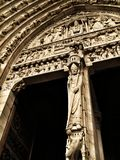 Notre Dame door bas relief. Intricate bas relief carvings on the doorway of the Notre Dame Cathedral in Paris, France Stock Images