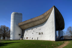 Notre-Dame-du-Haut Chapel at Ronchamp, France. The Chapel Notre-Dame-du-Haut bears the sign of its famous architect, Le Corbusier. High on a hill above the Royalty Free Stock Photos