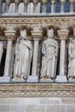 Notre dame facade statue detail Stock Image