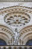 Notre dame facade statue detail Stock Photography