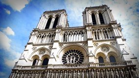 Notre Dame, Face against the Clouds, Paris, France. Notre Dame contrasted against wispy clouds in Paris, France Royalty Free Stock Photos