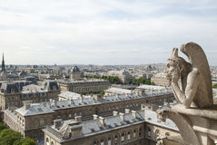 Notre Dame Gargoyle over Paris Royalty Free Stock Images