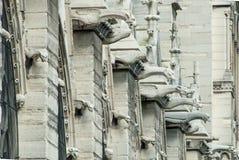 Notre Dame Gargoyles on a Wall Royalty Free Stock Photo