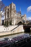 Notre Dame with glass boat Royalty Free Stock Image