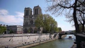 Notre Dame at Ile de la Cite. Paris, France. The gotic cathedral Notre Dame at Ile de la Cite. Paris, France. The shot is taken from a bridge over the Seine. The stock video footage