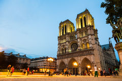 Notre Dame by night. The Notre Dame cathedral in Paris lit up by lights on a summers evening royalty free stock image