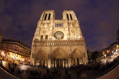Notre Dame in night with fisheye on Paris Stock Images