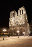 Notre Dame at night with people in Paris Royalty Free Stock Images