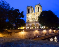 Notre Dame at night. Night view of Notre Dame de Paris, the world famous cathedral on the city island of Paris in the Seine river royalty free stock images