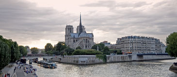 Notre dame Paris. Panoramic Notre-Dame de Paris and Seine river  on sunset Royalty Free Stock Photography
